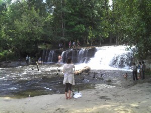 The top level of Phnom Kulen waterfalls. Some people bathe there.